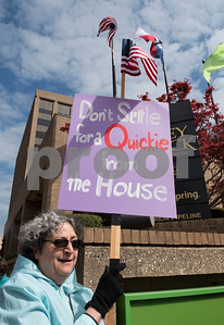 Karen Snedecor of Hawkins holds a sign outside of the Regions Bank Building where U.S. Sen. John Cornyn's office is located in Tyler Wednesday March 15, 2017. The demonstration was organized by Indivisible of Smith County, a group which is asking senators to vote against the Republican plan to replace the Patient Protection and Affordable Care Act, also known as Obamacare.  (Sarah A. Miller/Tyler Morning Telegraph)