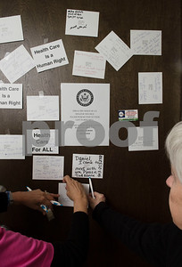 Constituents who support the Affordable Care Act leave notes on Sen. Ted Cruz's door in Tyler Wednesday March 15, 2017. The demonstration was organized by Indivisible of Smith County, a group which is asking senators to vote against the Republican plan to replace the Patient Protection and Affordable Care Act, also known as Obamacare.  (Sarah A. Miller/Tyler Morning Telegraph)