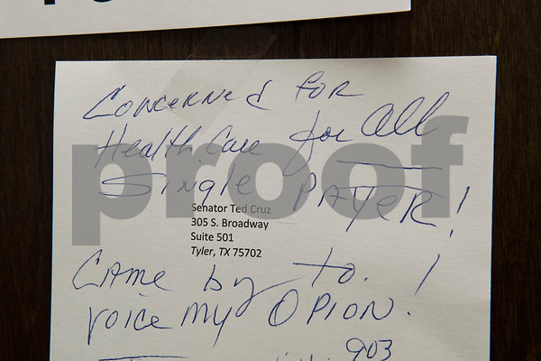 A note is left by a demonstrator on the door of Sen. Ted Cruz's office in Tyler Wednesday March 15, 2017. The demonstration was organized by Indivisible of Smith County, a group which is asking senators to vote against the Republican plan to replace the Patient Protection and Affordable Care Act, also known as Obamacare.  (Sarah A. Miller/Tyler Morning Telegraph)