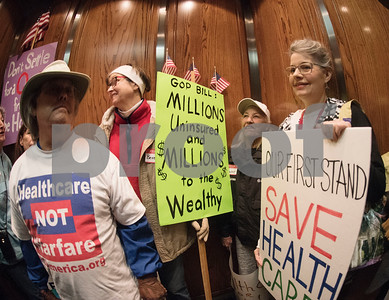 Demonstrators ride in the elevator up to U.S. Sen. John Cornyn's office in Tyler Wednesday March 15, 2017. The demonstration was organized by Indivisible of Smith County, a group which is asking senators to vote against the Republican plan to replace the Patient Protection and Affordable Care Act, also known as Obamacare.  (Sarah A. Miller/Tyler Morning Telegraph)