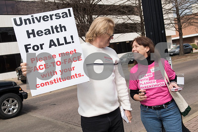 Mike Nichols and Nancy Nicols of Tyler demonstrate outside of the Regions Bank Building where U.S. Sen. John Cornyn's office is located in Tyler Wednesday March 15, 2017. The demonstration was organized by Indivisible of Smith County, a group which is asking senators to vote against the Republican plan to replace the Patient Protection and Affordable Care Act, also known as Obamacare.  (Sarah A. Miller/Tyler Morning Telegraph)