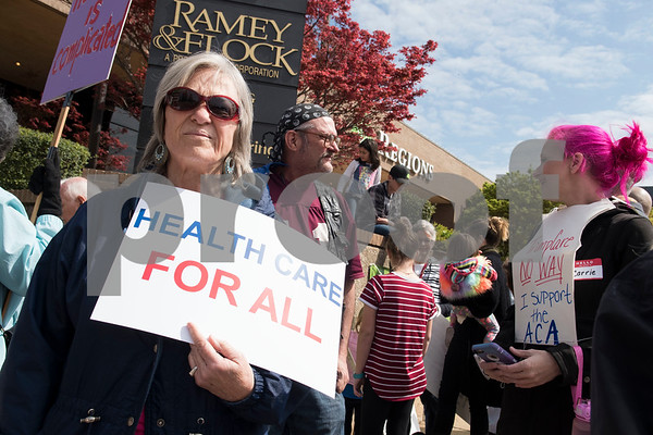 Demonstrators gather outside of the Regions Bank Building where U.S. Sen. John Cornyn's office is located in Tyler Wednesday March 15, 2017. The demonstration was organized by Indivisible of Smith County, a group which is asking senators to vote against the Republican plan to replace the Patient Protection and Affordable Care Act, also known as Obamacare.  (Sarah A. Miller/Tyler Morning Telegraph)