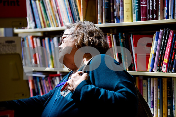 Linda Hutchins browses books during a spring book sale at the Tyler Public Library in Tyler, Texas, on Wednesday, March 15, 2017. The bi-annual sale, which runs through Sunday, includes thousands of adult and children's fiction and non-fiction books, as well as audio books, music cassettes and videotapes, most of which is priced at one dollar or less. (Chelsea Purgahn/Tyler Morning Telegraph)