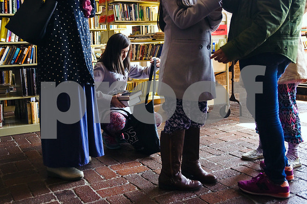 A young girl adds books to her bag during a spring book sale at the Tyler Public Library in Tyler, Texas, on Wednesday, March 15, 2017. The bi-annual sale, which runs through Sunday, includes thousands of adult and children's fiction and non-fiction books, as well as audio books, music cassettes and videotapes, most of which is priced at one dollar or less. (Chelsea Purgahn/Tyler Morning Telegraph)