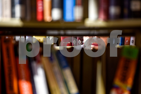 A woman browses bookshelves during a spring book sale at the Tyler Public Library in Tyler, Texas, on Wednesday, March 15, 2017. The bi-annual sale, which runs through Sunday, includes thousands of adult and children's fiction and non-fiction books, as well as audio books, music cassettes and videotapes, most of which is priced at one dollar or less. (Chelsea Purgahn/Tyler Morning Telegraph)