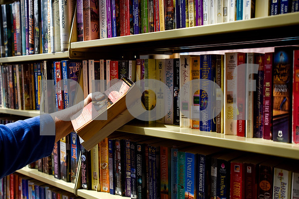 Eloise Rains looks for books during a spring book sale at the Tyler Public Library in Tyler, Texas, on Wednesday, March 15, 2017. The bi-annual sale, which runs through Sunday, includes thousands of adult and children's fiction and non-fiction books, as well as audio books, music cassettes and videotapes, most of which is priced at one dollar or less. (Chelsea Purgahn/Tyler Morning Telegraph)