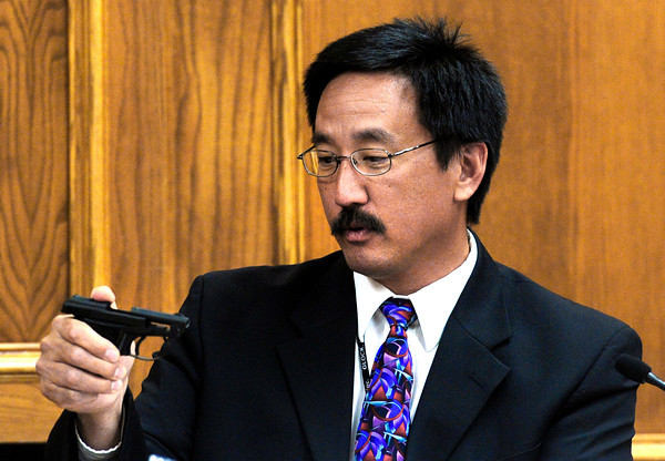 Dale Higashi, the Colorado Bureau of Investigation firearms expert, explains how a 22 Caliber gun operates during the trial of Adam Raszynski Friday March 16, 2012 at the Boulder County Justice Center. Raszynski, is charged with murdering his mother in Lafayette after being shot by her just over a year ago.<br /> Photo by Paul Aiken / The Boulder Camera