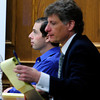 "Adam Raszynski listens to testimony as he sits with his attorney Seth Temin, at right,  during his trial on Friday March 16, 2012 at the Boulder County Justice Center. Raszynski, is charged with murdering his mother in Lafayette after being shot by her just over a year ago.<br /> Photo by Paul Aiken / The Boulder Camera  For more photos of the trial go to <a href=""http://www.dailycamera.com"">http://www.dailycamera.com</a>.<br /> Photo by Paul Aiken / The Boulder Camera"
