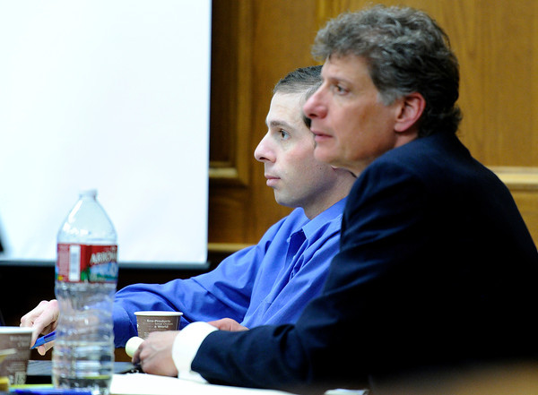 Adam Raszynski, left, sits next to defense attorney Seth Temin as he listens to his father, Dr. Andre Raszynski's testimony on Friday, March 16, during the third day of the Adam Raszynski murder trial at the Boulder County Justice Center in Boulder. Raszynski is on trial for the murder of his mother Rita Redford.<br /> Jeremy Papasso/ Camera