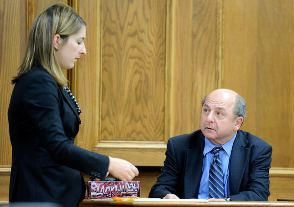 Defense attorney Kathryn Herold shows Dr. Andre Raszynski, Adam Raszynski's father, a note allegedly written by Rita Redford on Friday, March 16, during the third day of the Adam Raszynski murder trial at the Boulder County Justice Center in Boulder. Raszynski is on trial for the murder of his mother Rita Redford.<br /> Jeremy Papasso/ Camera