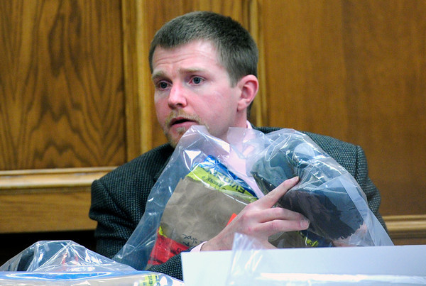 Gentry Roth, a blood analysis expert with the Colorado Bureau of Investigation shows where he took blood samples from Adam Raszynski's shoes on Friday March 16, 2012 at the Boulder County Justice Center. Raszynski, is charged with murdering his mother in Lafayette after being shot by her just over a year ago.<br /> Photo by Paul Aiken / The Boulder Camera