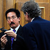 Dale Higashi, the Colorado Bureau of Investigation firearms expert, explains how a 22 Caliber gun operates while being interviews by defense consul Seth Temin during the trial of Adam Raszynski Friday March 16, 2012 at the Boulder County Justice Center. Raszynski, is charged with murdering his mother in Lafayette after being shot by her just over a year ago.<br /> Photo by Paul Aiken / The Boulder Camera