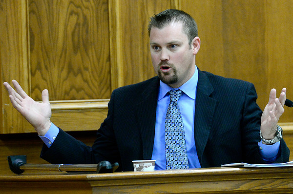Gary Thatcher, former detective Lafayette police department, shows how Adam Raszynski described holding his arms when Raszynski saw his mother with a gun during Raszynsky's trial at the Boulder County Justice Center in Boulder, Colorado March 19, 2012.  Raszynski is charged with second degree murder in the death of his mother Rita Redford. CAMERA/MARK LEFFINGWELL