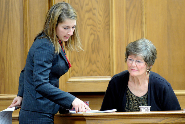"Defense attorney Kathryn Herold points to written words previously used in a testimony by Beverly Moore, Rita Redfords friend, while cross-examining Mrs. Moore on Monday, March 19, during the Adam Raszynski murder trial at the Boulder County Justice Center in Boulder. Raszynski is trial for the murder of his mother Rita Redford. For more photos of the trial go to  <a href=""http://www.dailycamera.com"">http://www.dailycamera.com</a><br /> Jeremy Papasso/ Camera"