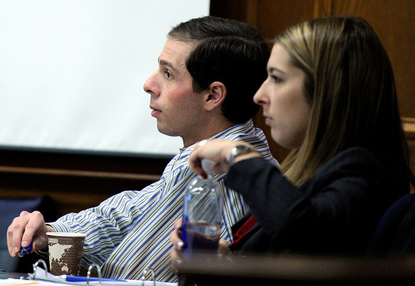 "Adam Raszynski, left, sits next to his defense attorney Kathryn Herold while listening to the testimony of former Lafayette police detective Gary Thatcher, not pictured, on Monday, March 19, during the Adam Raszynski murder trial at the Boulder County Justice Center in Boulder. Raszynski is trial for the murder of his mother Rita Redford. For more photos of the trial go to  <a href=""http://www.dailycamera.com"">http://www.dailycamera.com</a><br /> Jeremy Papasso/ Camera"