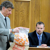 "Defense attorney Seth Temin, left, shows a bag of prescription pill containers to former Lafayette police detective Gary Thatcher on Monday, March 19, during the Adam Raszynski murder trial at the Boulder County Justice Center in Boulder. Raszynski is trial for the murder of his mother Rita Redford. For more photos of the trial go to  <a href=""http://www.dailycamera.com"">http://www.dailycamera.com</a><br /> Jeremy Papasso/ Camera"