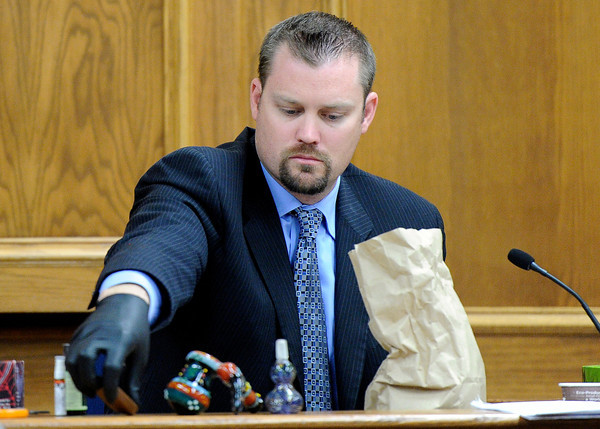 "Former Lafayette police detective Gary Thatcher looks at marijuana paraphernalia found in the bedroom of Rita Redford on Monday, March 19, during the Adam Raszynski murder trial at the Boulder County Justice Center in Boulder. Raszynski is trial for the murder of his mother Rita Redford. For more photos of the trial go to  <a href=""http://www.dailycamera.com"">http://www.dailycamera.com</a><br /> Jeremy Papasso/ Camera"