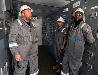 Motor men Chad O'Brien, Charlie Graham and Marcus Edwards talk about the breakers in the Norseman II Series Scan Titan drilling rig during a public tour on Monday, March 18, 2019 at the Scandrill rig-up yard in Tyler.   (Sarah A. Miller/Tyler Morning Telegraph)