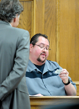 "David Chavez, with the Silver Bullet Shooting Range in Wheat Ridge, testifies that Rita Redford used their facility once in the past to practice shooting on Tuesday, March 20, during the second-degree murder trial of Adam Raszynski at the Boulder County Justice Center in Boulder. Raszynski is on trial for the murder of his mother Rita Redford. For more photos of the trial go to  <a href=""http://www.dailycamera.com"">http://www.dailycamera.com</a><br /> Jeremy Papasso/ Camera"