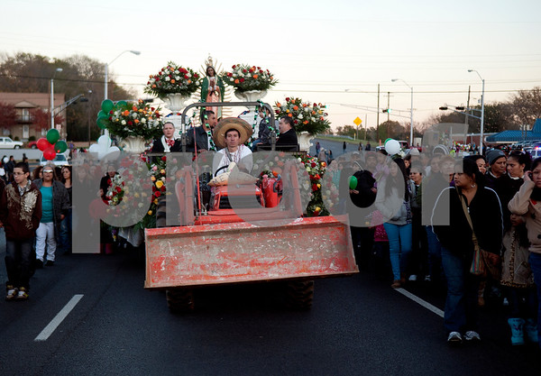 A float from the St. Peter Claver Catholic Church makes its way down Gentry Street in Tyler during the Our Lady of Guadalupe Parade Sunday evening. December 12 marks the feastday of the Virgin Mary, or Lady of Guadalupe, the patron saint of the Americas who appeared to Juan Diego in Mexico City in 1531. Her appearance lead many Mexicans to convert to Christianity, and they show their devotion and gratefulness to Mary through the celebration that includes dance and music as a symbolism of prayer.   (copyright Sarah A. Miller / Tyler Morning Telegraph)