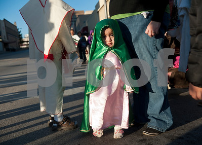 Maria Lopez, 2, of Tyler, wears a green cloak to portray the Virgin Mary at the Our Lady of Guadalupe Parade Sunday evening Dec. 11 in Tyler, Texas. She attended the parade with her mother Fabiola and brother Joshua, 7. December 12 marks the feast day of the Virgin Mary, or Lady of Guadalupe, the patron saint of the Americas who appeared to Juan Diego in Mexico City in 1531. Her appearance lead many Mexicans to convert to Christianity, and they show their devotion and gratefulness to Mary through the celebration that includes dance and music as a symbolism of prayer.      (copyright Sarah A. Miller / Tyler Morning Telegraph)