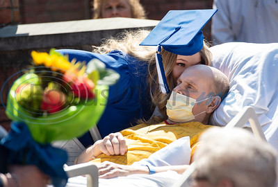 Lindale High School senior Christan Patterson leans in to kiss her father Mark Patterson at the conclusion of her mock graduation ceremony at Hospice of East Texas in Tyler on Wednesday March 20, 2019. Being able to see Christan graduate was one of Mark's life goals. Mark has late stage Esophageal cancer.   (Sarah A. Miller/Tyler Morning Telegraph)