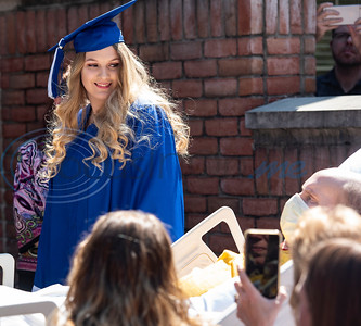 Lindale High School senior Christan Patterson walks past her father Mark Patterson during her mock graduation ceremony at Hospice of East Texas in Tyler on Wednesday March 20, 2019. Being able to see Christan graduate was one of Mark's life goals. Mark has late stage Esophageal cancer.   (Sarah A. Miller/Tyler Morning Telegraph)