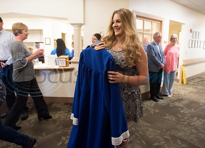Lindale High School senior Christan Patterson gets ready as the school, family and friends host a mock graduation ceremony for her father Mark Patterson to attend at Hospice of East Texas in Tyler on Wednesday March 20, 2019. Being able to see Christan graduate was one of Mark's life goals. Mark has late stage Esophageal cancer.   (Sarah A. Miller/Tyler Morning Telegraph)