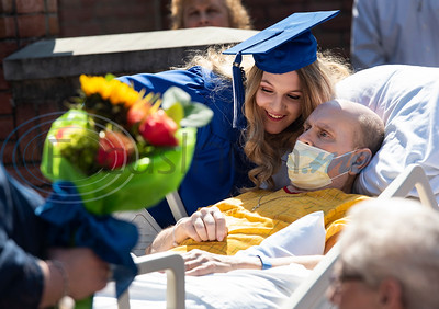 Lindale High School senior Christan Patterson leans in close to her father Mark Patterson at the conclusion of her mock graduation ceremony at Hospice of East Texas in Tyler on Wednesday March 20, 2019. Being able to see Christan graduate was one of Mark's life goals. Mark has late stage Esophageal cancer.   (Sarah A. Miller/Tyler Morning Telegraph)