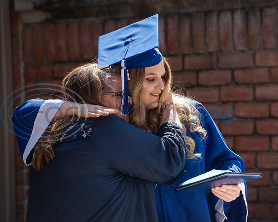 Darla Patterson hugs her daughter, Lindale High School senior Christan Patterson, as the school, family and friends host a mock graduation ceremony for her father Mark Patterson to attend at Hospice of East Texas in Tyler on Wednesday March 20, 2019. Being able to see Christan graduate was one of Mark's life goals. Mark has late stage Esophageal cancer.   (Sarah A. Miller/Tyler Morning Telegraph)