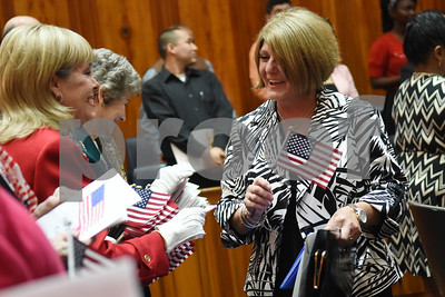 Susan Swaak of Hideaway receives an American flag during a naturalization ceremony held at the United States District Court for the Eastern District of Texas in Tyler Thursday morning. Swaak immigrated to the United States from South Africa.   (Sarah A. Miller/Tyler Morning Telegraph)
