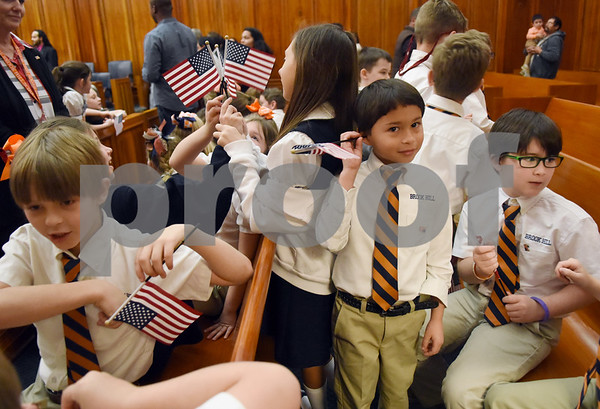 Third graders from The Brook Hill School attend a naturalization ceremony held at the United States District Court for the Eastern District of Texas in Tyler Thursday morning. Forty immigrants from 17 different countries became United States citizens during the ceremony.  (Sarah A. Miller/Tyler Morning Telegraph)