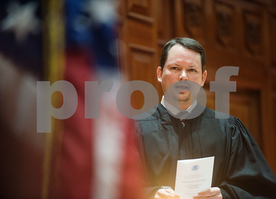 U.S. Magistrate Judge John D. Love sings the National Anthem during a naturalization ceremony held at the United States District Court for the Eastern District of Texas in Tyler Thursday morning. Forty immigrants from 17 different countries became United States citizens during the ceremony.  (Sarah A. Miller/Tyler Morning Telegraph)