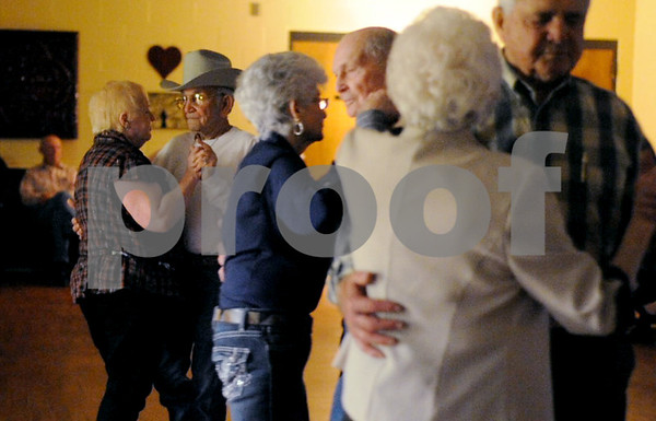 photo by Sarah A. Miller/Tyler Morning Telegraph  Couples dance to music played by Patrick Odom at the Tyler Senior Center Friday Night Dance Friday March 21.