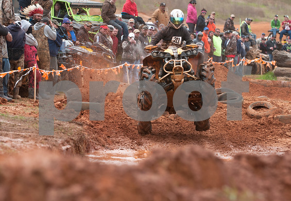 photo by Sarah A. Miller/Tyler Morning Telegraph  Brian Bowden rides his all terrain vehicle in the High Lifter ATV Mud Nationals obstacle course competition Thursday March 26, 2015 at Mud Creek Off-Road Park in Jacksonville, Texas. High Lifter ATV Mud Nationals is an annual event that draws thousands of people of all ages from across the country to camp, ride all terrain vehicles and participate in and watch various ATV competitions. Mud Nationals continues Friday, Saturday and Sunday.