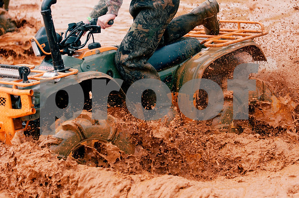 photo by Sarah A. Miller/Tyler Morning Telegraph  Adam Smoot of Orange, Texas rides his all terrain vehicle through a mud pit Thursday March 26, 2015 at Mud Creek Off-Road Park in Jacksonville, Texas during the High Lifter ATV Mud Nationals. High Lifter ATV Mud Nationals is an annual event that draws thousands of people of all ages from across the country to camp, ride all terrain vehicles and participate in and watch various ATV competitions. Mud Nationals continues Friday, Saturday and Sunday.