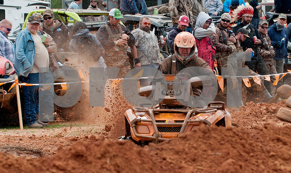 photo by Sarah A. Miller/Tyler Morning Telegraph  Craig Treadwell of team Arkansas Mud Slingers rides his all terrain vehicle in the High Lifter ATV Mud Nationals obstacle course competition Thursday March 26, 2015 at Mud Creek Off-Road Park in Jacksonville, Texas. High Lifter ATV Mud Nationals is an annual event that draws thousands of people of all ages from across the country to camp, ride all terrain vehicles and participate in and watch various ATV competitions. Mud Nationals continues Friday, Saturday and Sunday.