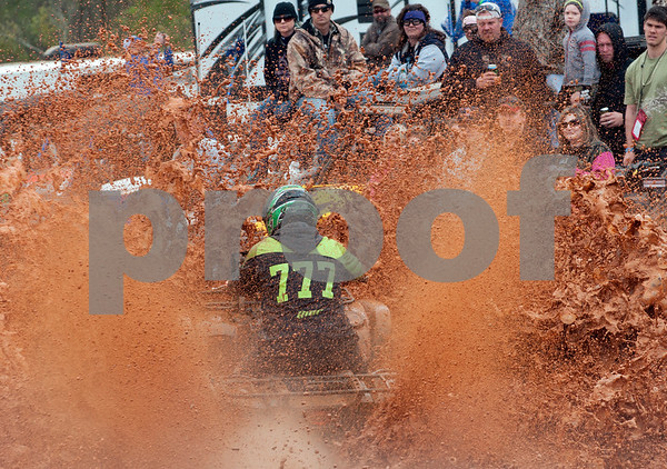 photo by Sarah A. Miller/Tyler Morning Telegraph  Pete Hines splashes mud as he rides his all terrain vehicle in the High Lifter ATV Mud Nationals obstacle course competition Thursday March 26, 2015 at Mud Creek Off-Road Park in Jacksonville, Texas. High Lifter ATV Mud Nationals is an annual event that draws thousands of people of all ages from across the country to camp, ride all terrain vehicles and participate in and watch various ATV competitions. Mud Nationals continues Friday, Saturday and Sunday.