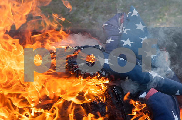 United States flags are burned in a dignified retirement ceremony held by The Capt. William Barron Chapter of the Sons of the American Revolution Saturday March 26, 2016 at the Tyler Memorial Cemetery. Cub Scouts from Pack 333 assisted in the ceremony. Over three-hundred torn and faded United States flags were retired.  (Sarah A. Miller/Tyler Morning Telegraph)