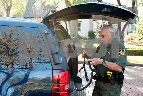 photo by Sarah A. Miller/Tyler Morning Telegraph  Cherokee Constable Eddie Lee takes German Shepherd Cody to Bergfeld Park in Tyler Monday.