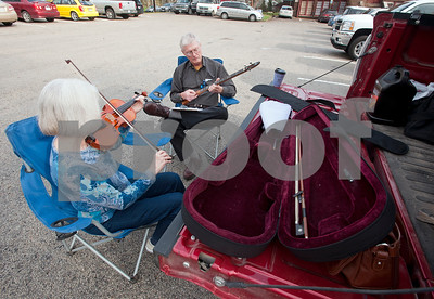 photo by Sarah A. Miller/Tyler Morning Telegraph  Margaret Byrum of Garland, Texas plays a song on fiddle along with her husband Chuck Byrum on a picking stick in the parking lot outside of the Museum for East Texas Culture where the Palestine Old Time Music and  Dulcimer Festival is being held in Palestine, Texas Friday. The three day festival draws in musicians from all across the United States to attend concerts, workshops and jam sessions featuring old time instruments such as dulcimers, concertinas, autoharps, harmonicas, guitars, mandolins and fiddles.