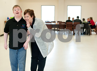 photo by Sarah A. Miller/Tyler Morning Telegraph  Achieving Dreams executive director Denise Carter of Tyler poses with her son Matthew Carter Wednesday. Achieving Dreams is a new day program for adults with special needs that meets in Tyler.