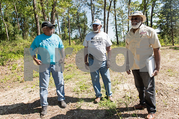 Brothers Gene Turner, Wilson Turner and  Eddie Turner along with Hugh Mitchell (not pictured) uncovered the cemetery at the former Dickson Colored Orphanage grounds in Gilmer, Texas.   (Sarah A. Miller/Tyler Morning Telegraph)