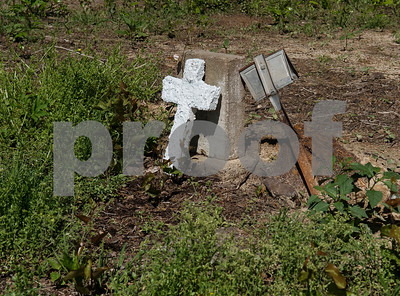 A headstone for Sallie Dixon is pictured at the Dickson Colored Orphanage cemetery in Gilmer, Texas.   (Sarah A. Miller/Tyler Morning Telegraph)