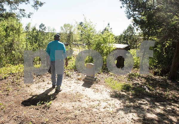 Gene Turner walks toward a headstone at the Dickson Colored Orphanage cemetery in Gilmer, Texas. Turner and his brothers have been working to uncover the cemetery.  (Sarah A. Miller/Tyler Morning Telegraph)