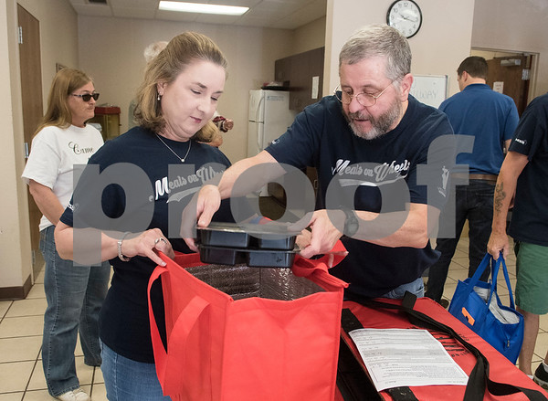 Meals on Wheels Ministry volunteers Elaine Goad and Randy Goad pack their warm meals for their delivery route Thursday March 30, 2017.  (Sarah A. Miller/Tyler Morning Telegraph)