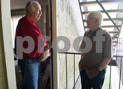 Larry Holland of Tyler talks with Meals on Wheels Ministry volunteer Michael Rogers as he receives his meal at his apartment Thursday March 30, 2017.  (Sarah A. Miller/Tyler Morning Telegraph)