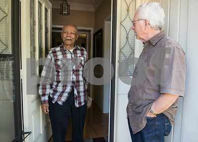 Ernest Mason of Tyler talks with Meals on Wheels Ministry volunteer Michael Rogers as he receives his meal at his apartment Thursday March 30, 2017.  (Sarah A. Miller/Tyler Morning Telegraph)