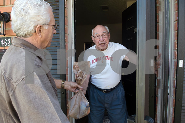 Meals on Wheels Ministry volunteer Michael Rogers gives Charles Holmen an additional two shelf stable meals with his warm meal Thursday March 30, 2017. Meals on Wheels Ministry currently serves 3,000 seniors and homebound individuals in 30 communities across six counties including Gregg, Henderson, Smith, Upshur, Van Zandt, and Wood counties.  (Sarah A. Miller/Tyler Morning Telegraph)