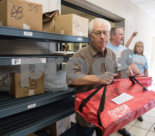 Meals on Wheels Ministry volunteer Michael Rogers picks up his warm meals to deliver on his route Thursday March 30, 2017.  (Sarah A. Miller/Tyler Morning Telegraph)